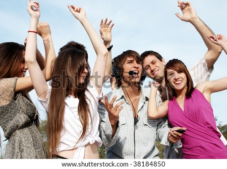 Group of young guys and girls having fun on the nature - stock photo