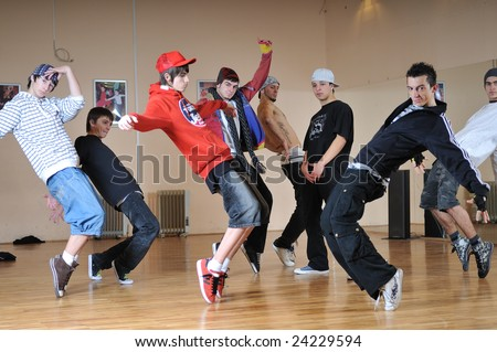 group of young happy boys dance  together in dence studio - stock photo
