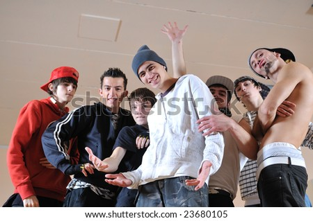 group of young happy boys posing  together in dence studio - stock photo