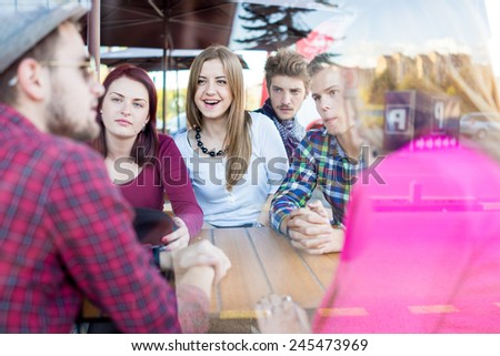 Group of young happy people enjoying and having fun - stock photo