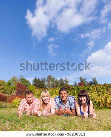 Group of young happy people outdoor - stock photo