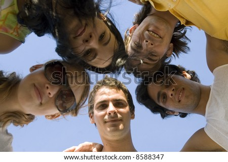 Group of young happy people with heads together