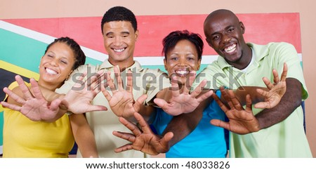 group of young happy South African people  in front of South Africa flag, 2010 FIFA world cup concept