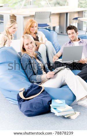 Group of young high-school or university students  learning and relaxing - stock photo