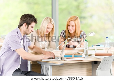 Group of young high school students learning relaxing with books