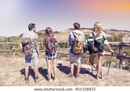 group of young hikers in the mountains preparing an excursion - stock photo