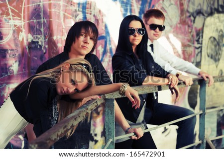 Group of young men and women at abandoned apartment - stock photo