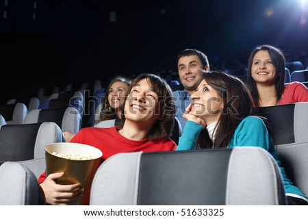 Group of young men at cinema - stock photo