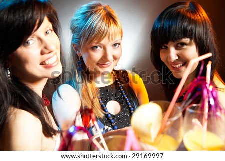 group of young modern caucasian women at the disco