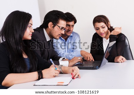 group of young multiracial business people in meeting - stock photo