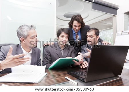 group of young multiracial businessmen in a meeting - stock photo