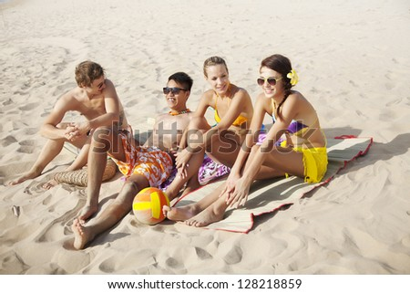 group of young people at the beach - stock photo