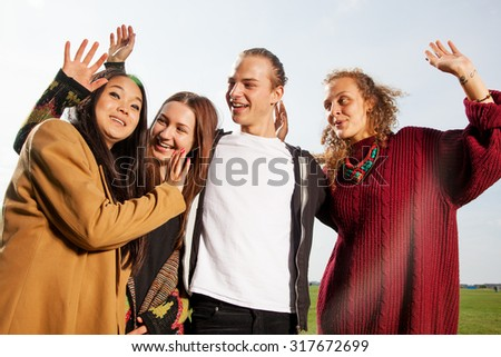 Group of young people at the waving