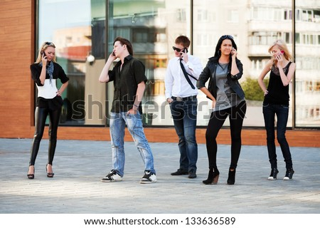Group of young people calling on the mobile phones - stock photo