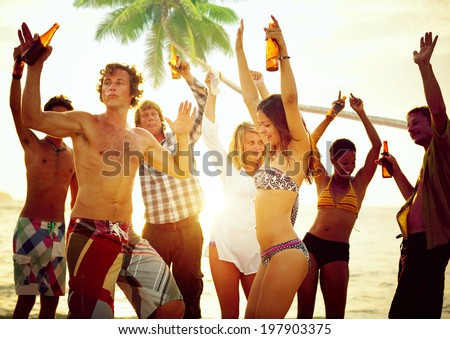 Group of Young People Celebrating by the Beach - stock photo