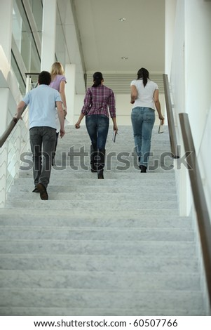 Group of young people climbing stairs