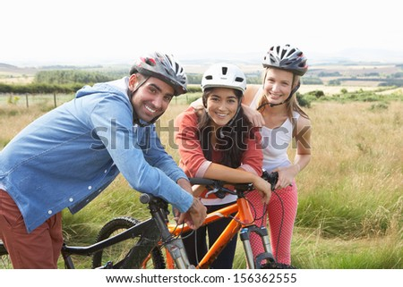 Group Of Young People Cycling In Countryside - stock photo