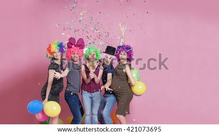 Group of young people disguised for a party. Large copy space on right.