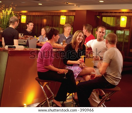 Group of young people drinking in a bar - stock photo