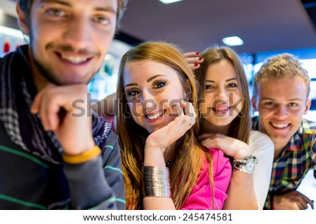 Group of young people enjoying and having fun smiling - stock photo