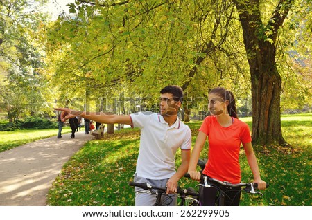 group of young people enjoying in the bikes having fun at beautiful sunny day - stock photo