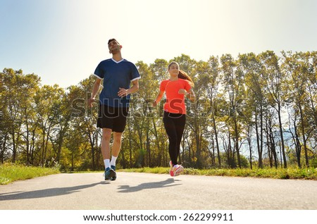 group of young people enjoying in the fitness having fun at beautiful sunny day - stock photo