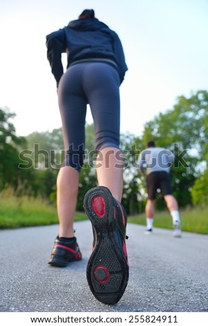 group of young people enjoying in the fitness having fun at beautiful sunny morning - stock photo