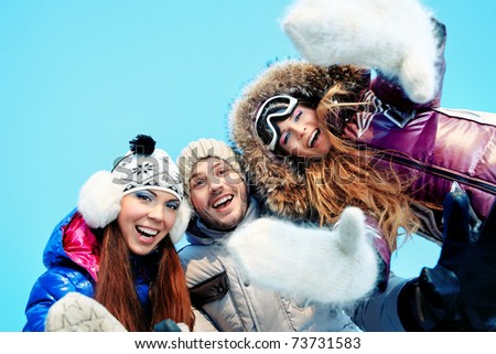 Group of young people having a rest outdoor in winter. - stock photo
