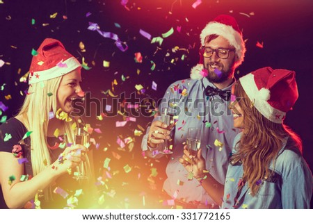 Group of young people having a toast at midnight on a New Year's Eve - stock photo