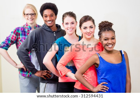 Group of young people having dance lessons - stock photo
