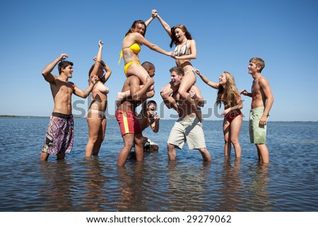 Group of young people having fun at the beach - stock photo