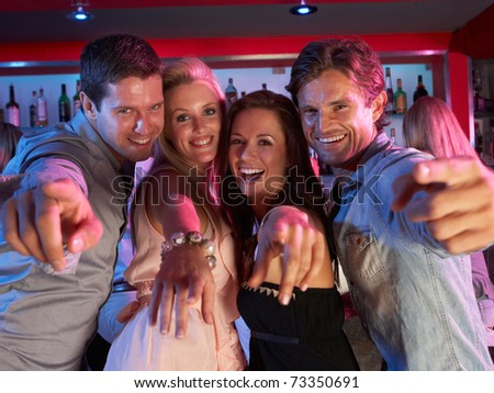 Group Of Young People Having Fun In Busy Bar - stock photo