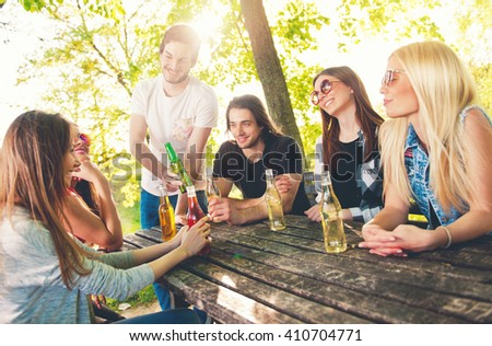 Group of young people having fun outdoors  - stock photo