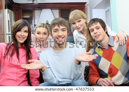 Group of young people having fun together at home. - stock photo