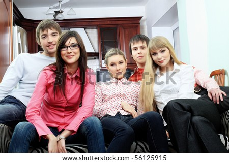 Group of young people having fun together at home.