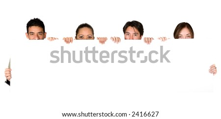 group of young people holding a white card - stock photo