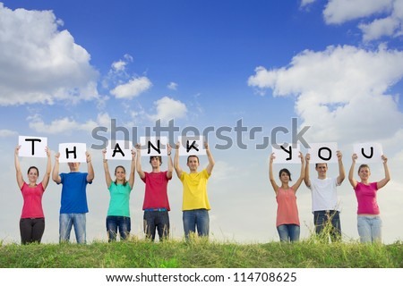 Group of young people holding papers with the words thank you - stock photo