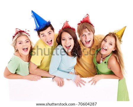 Group of young people in party hat holding banner. Isolated. - stock photo