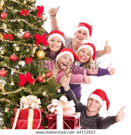Group of young people in santa hat show thumb. Isolated. - stock photo