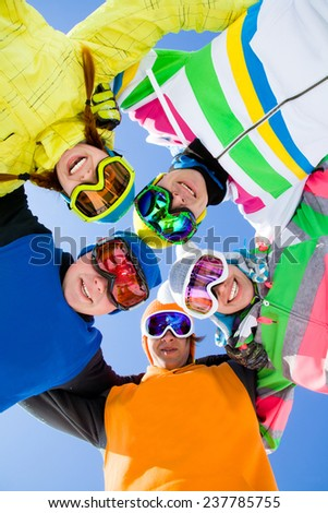 Group of young people in ski glasses on ski holiday in mountains - stock photo