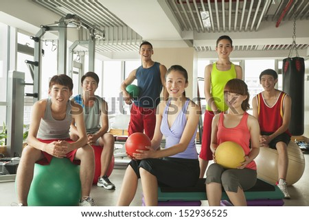 Group of young people in the gym, portrait