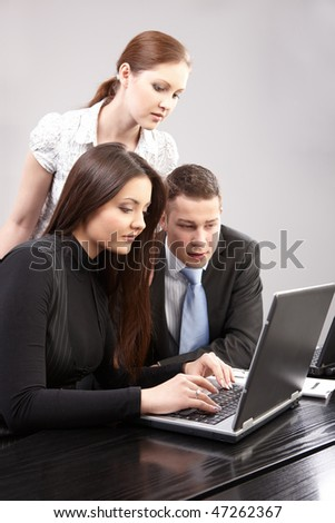 group of young people in the office working together - stock photo