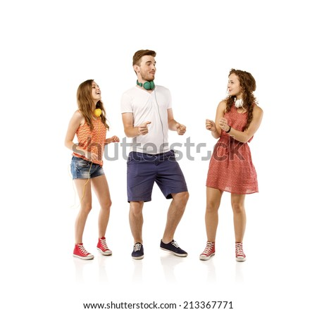 Group of young people listening to the music and dancing, isolated on white background. - stock photo