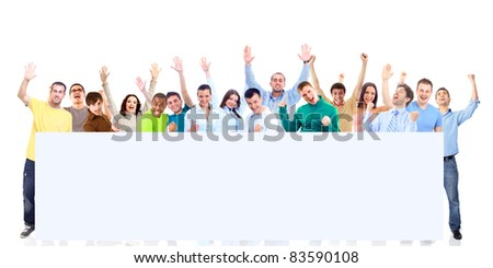 Group of young people looking out white board. - stock photo