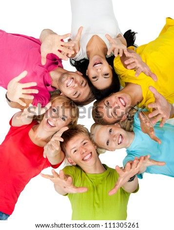 group of young people lying down on floor in circle holding open palm at you, teenage students happy excited smile top angle view isolated over white background