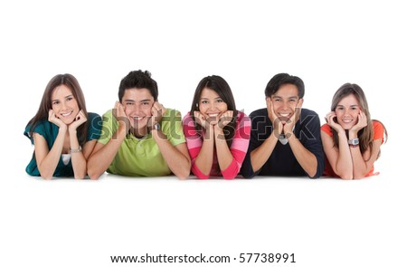 Group of young people lying on the floor - isolated over a white background - stock photo