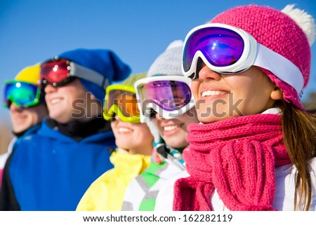 Group of young people on ski holiday in mountains