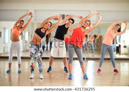 Group of young people on training at gym - stock photo