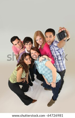 Group of young people photographing - stock photo