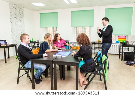 Group of young people playing board games - stock photo